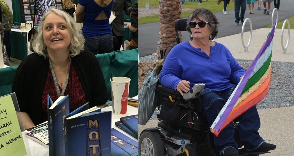 On the left, pale skinned a woman with short gray hair in a black sweater and red and black dress sits at a table in front of a stack of books and a soda cup. On the right, a white woman with short black and gray hair in a black and silver power chair, wearing sunglasses, a blue shirt, and black pants, holds a rainbow flag.